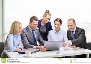 Business Team With Laptop Having Discussion Royalty Free