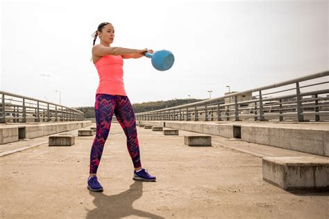 kettlebell swing swings fitness body exercises benefits doing variations ve exercise training resistance kettlebells workout workouts woman exercising popsugar shoulder