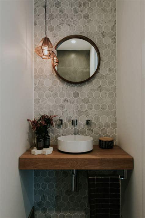 stunning powder room  marble hexagon wall tiles