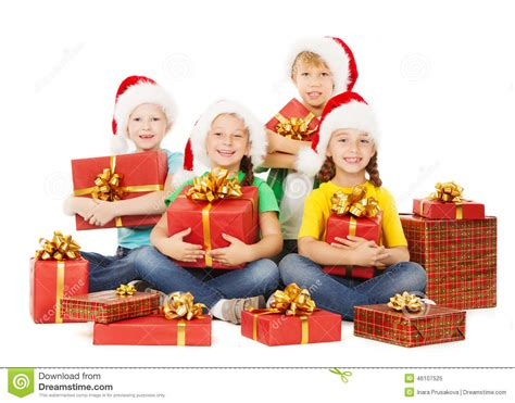 Christmas Kids Presents. Children In Hatewith With Gifts