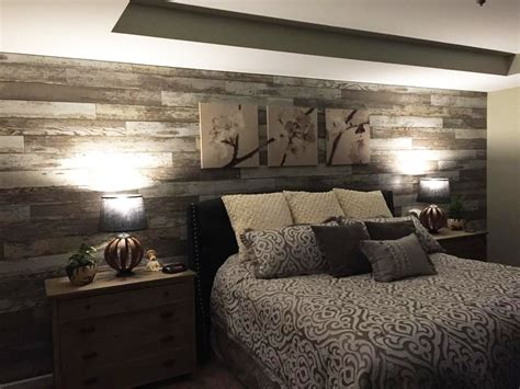 laminate for walls quot added laminate flooring to bedroom wall to give the room a distressed barn wood accent wall