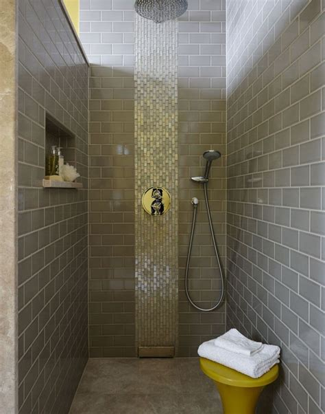 use concrete effect floor tiles in a walk in shower to create a smart industrial base wall to