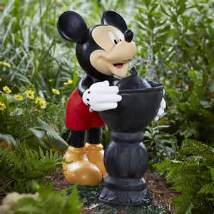 disney mickey taking a drink fountain outdoor living