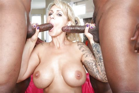 Busty Mature Lady Ryan Conner Giving 2 Huge Black Cocks