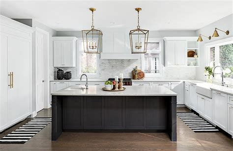 white kitchen with black island black and white stripe runners with black island