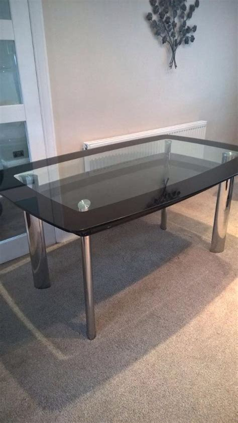 beautiful harveys boat dining table clear and black glass