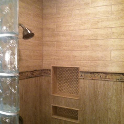 4x4 shower with glass block half wall and decorative tile