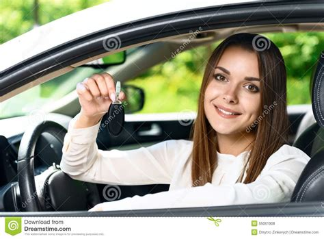 Pretty Girl Sitting Inside Car And Holding Key Stock Photo