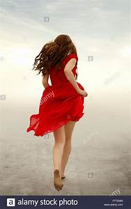 Woman in red dress running away Stock Photo, Royalty Free ...