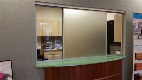 frosted horizontal roller reception window corporate