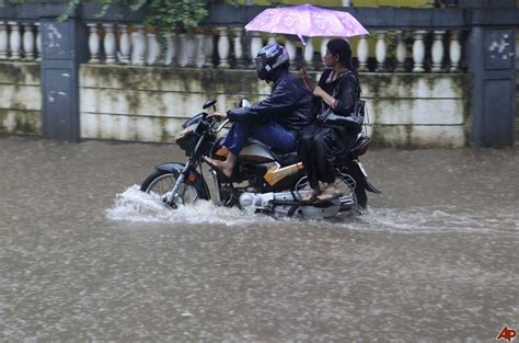 motorcycle rain india life is good even in the rain
