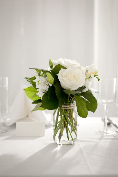 white flower table l simple glass or mason jars can work even outside of the