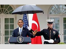 President Barack Obama's brolly gives Marine a face of