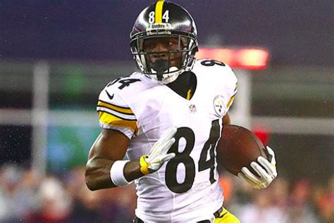antonio brown listed  questionable  playoff game
