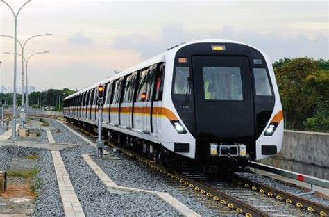 thomson east coast  train arrives  singapore