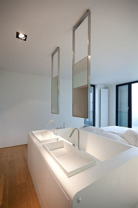 Hanging Mirror In Bathroom by Apartment Building In Luxembourg Metaform Architects