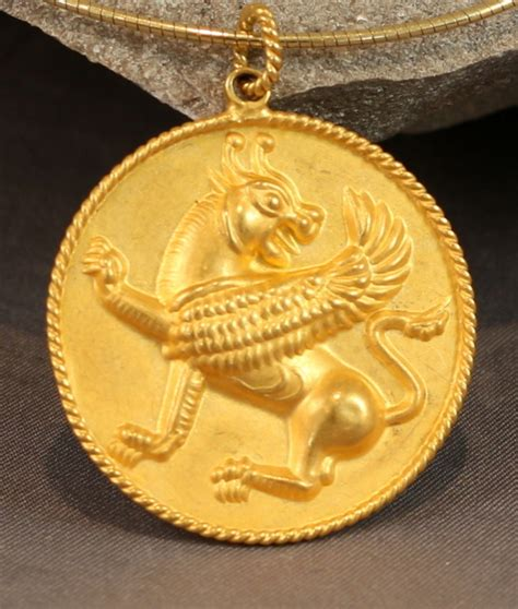 gold griffin medallion