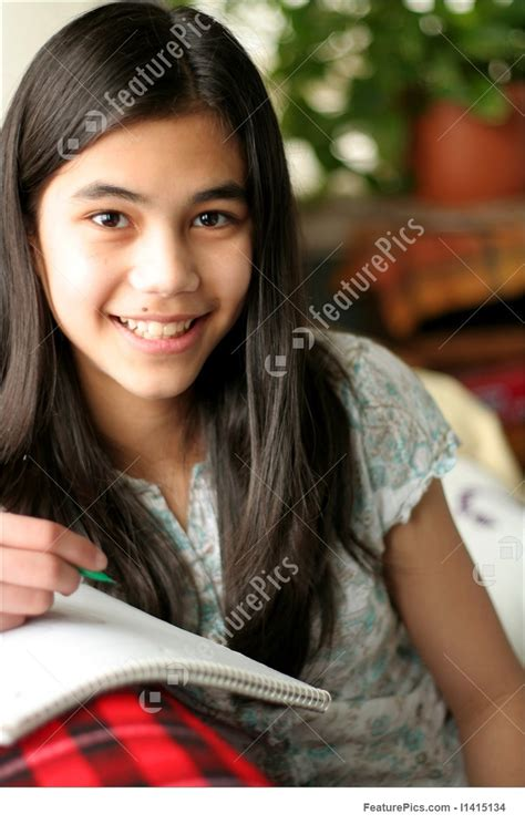 Young Teen Girl Writing In Her Notebook Stock Image I At Featurepics