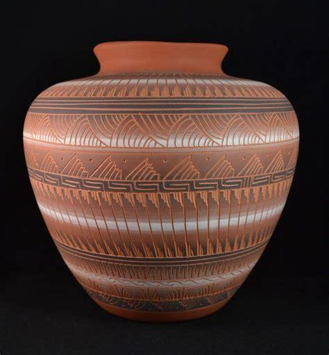 carved navajo pottery vase signed   artist vi kiug