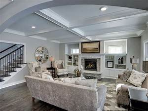 Traditional Living Room with High ceiling & Hardwood