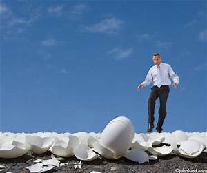 Picture of a Business Man Walking Over a Field of Egg Shells