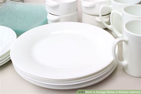 where to put dishes in kitchen cabinets 4 ways to arrange dishes in kitchen cabinets wikihow 2191