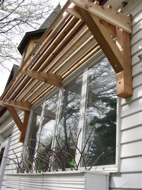 horizontal slat awning  wood house ideas