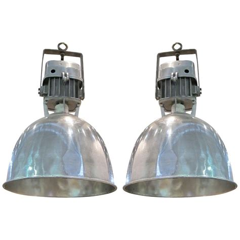 1940s pair of industrial light fixtures for sale