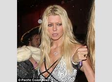 Tara Reid looks worse for wear as she takes a FALL outside