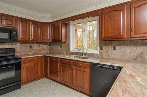 crema bordeaux granite with backsplash traditional