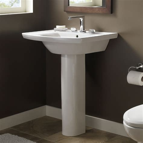 small pedestal sinks decorating a small bathroom qb