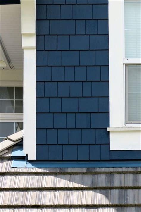 navy blue siding  shake    home stand