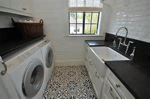 beautiful laundry room with quot hand painted concrete floor