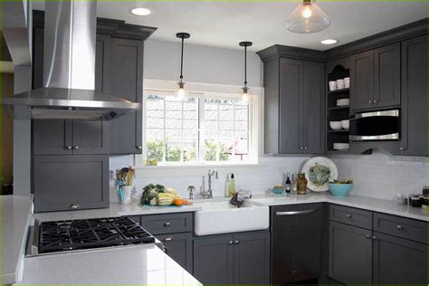 black metal kitchen cabinets light gray kitchen cabinets with black appliances 4733