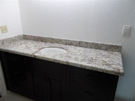 granite marble and quartz shower wall and tub deck
