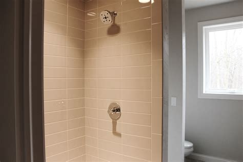 subway tile bathroom what s in tile showers right now and other flooring