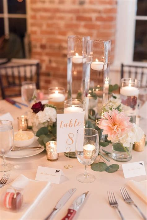 Floating candles and greenery wedding centerpiece with