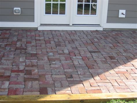 replacing concrete patio with brick in basket weave