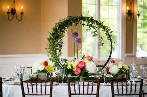 tracey reynolds floral design oval table  clematis