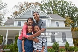 Black Family Standing Together In Front Of House Stock ...