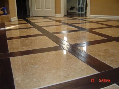 Beautiful walnut hardwood and travertine flooring