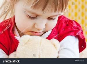 Sad Little Girl With A Teddy Bear Stock Photo 143949754 ...