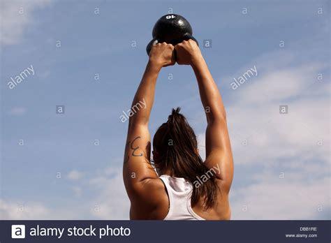 kettlebell crossfit swing workout woman alamy doing outside