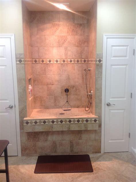 raised dog shower  heat lamp   nuheat tile