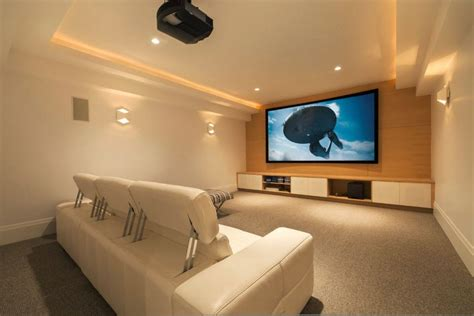home theater ideas for small rooms picture frame on the beige wall black leather sofas brown