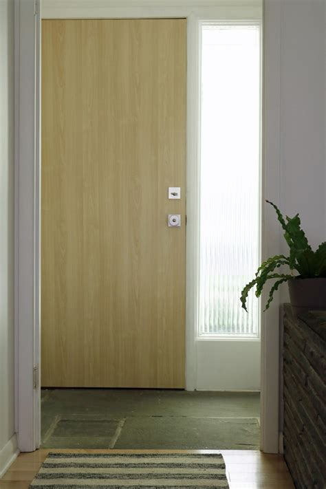 Bathroom Glass Door Cover by Update An Interior Door With Vinyl Adhesive Wallpaper