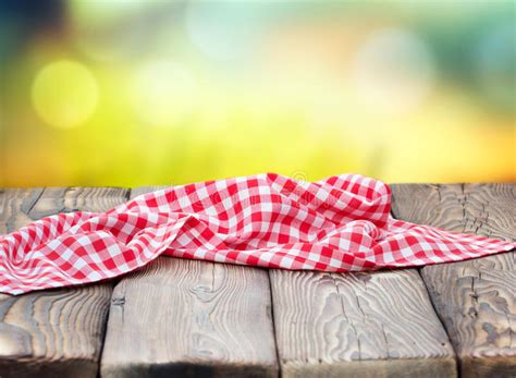 red picnic cloth  wooden table mature bokeh background