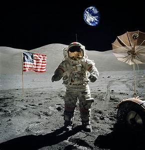 Astronaut On The Lunar Surface Earth On The Background ...