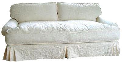 down filled slipcovered sofa down sofa pillows fluffing vs karate chopping throw
