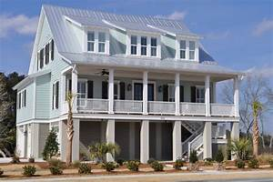 jacksonbuilt custom homes With light blue paint for tropical home design